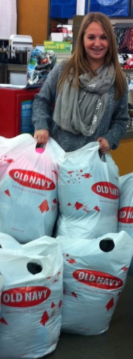 Rachel buying coats at Old Navy for the One Warm Coat Drive