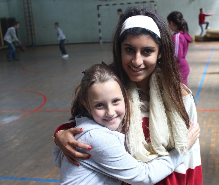 Sahar and a young Bosnian girl (Photo courtesy of Sahar Afrakhan)