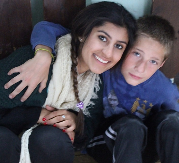 Sahar and a young Bosnian boy (Photo courtesy of Sahar Afrakhan)
